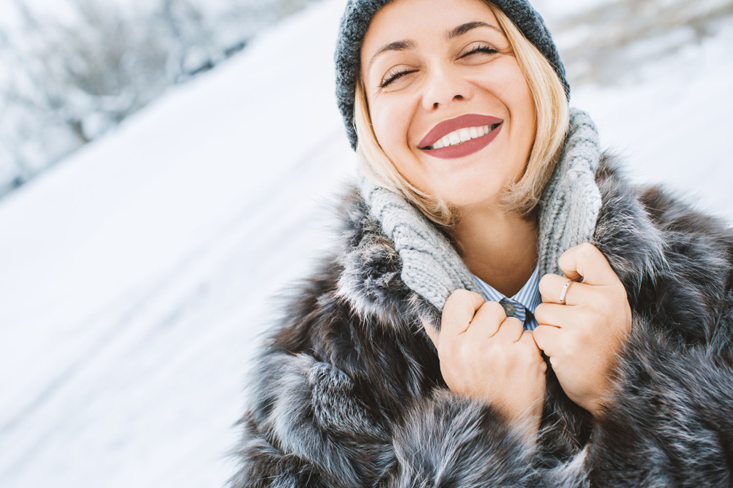 Woman enjoying beautiful skin in the winter