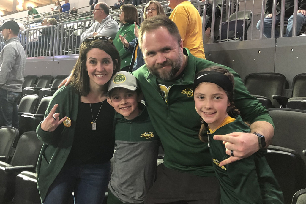 Heidi and her family at a Packer's game